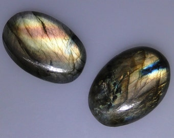 2 Labradorite oval cabs, lots of very good gold color flash, 70.01 carats total           043-10-643
