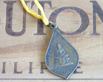 Vintage Buddha Buddhist Medal Necklace on a Yellow Silk Cord