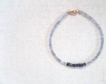 blue sapphire & iolite bracelet. blue sapphire and iolite thin stackable gemstone bracelet. gold vermeil detail. sapphire iolite jewelry