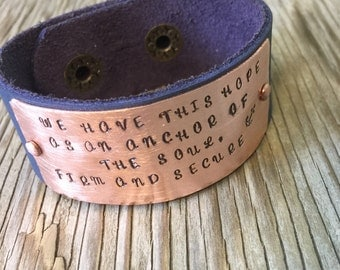 A riveted blue leather cuff bracelet with hand stamped copper plate we have this hope as an anchor of the soul Biblical verse Handmade