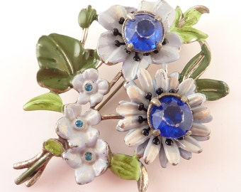 Painted Antique Silvertone Spinning Blue Flower Brooch with Large Blue Rhinestones