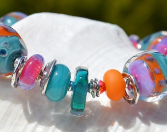 Reserve for Patrice-FOXY LADY-Handmade Lampwork and Sterling Silver Bracelet