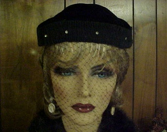 Black velvet mini  hat with rhinestones and face veil that ties in the back-