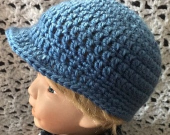 Medium blue baby hat with brim