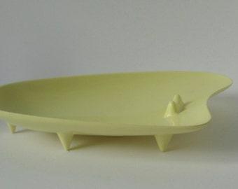 Mid Century Boomerang shaped Yellow Melamine Ashtray. Footed Atomic ashtray