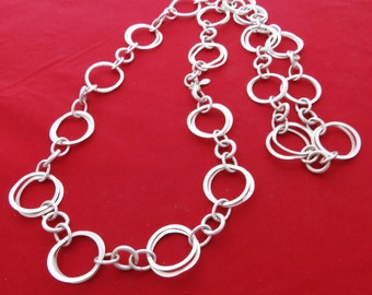 "Vintage PREMIER DESIGNS signed 30"" silver tone necklace with circle design in great condition"