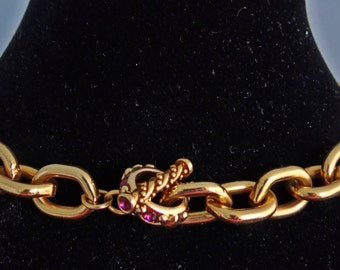 """20% off sale Chunky and heavy-Vintage gold tone 16"""" necklace in great condition with purple rhinestone toggle clasp"""