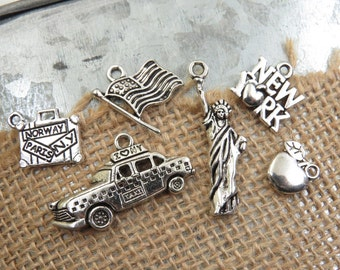 6 Assorted New York City Vacation Theme Charms -Each is Different- Antique Silver- Taxi Cab, Statue of Liberty, Big Apple, Flag, Suitcase
