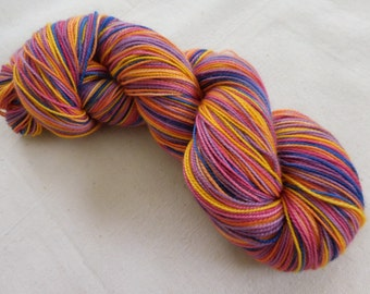 Midnight Sun Self-striping Superwash Merino and Nylon Sock Yarn -- Blue, gold, lavender, rose, peach