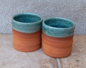 Pair of whisky tumbler or espresso coffee cup hand thrown terracotta pottery