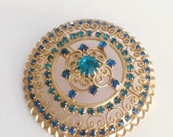 Beautiful Vintage Mid Century Era Gold Circular Brooch encrusted with Emerald stones