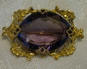 Beautiful vintage brooch, gold filled metal with amethyst color stone