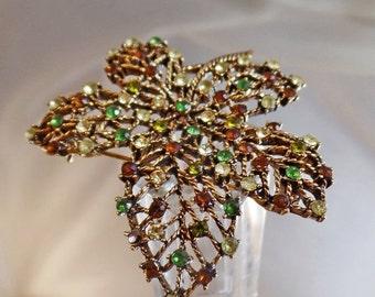 FALL SALE Vintage Monet Rhinestone Leaf Brooch. Gold Tone Leaf Pin with Green, Clear, Yellow, Brown Rhinestones.