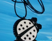 Lady Bug Tiki Medallion Necklace