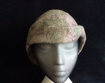 Here is a cloche style wet felted hand dyed merino wool hat with silk threads imbedded into the finish.