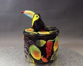 ceramic colourful Toucan trinket pot with lid figurine hand crafted Australian pottery flowers leaves