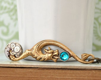 steampunk jewelry, statement piece, ANCIENT TIMES, vintage watch movement with dragon charm and blue jewels