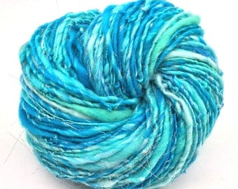 Handspun sparkly yarn, 100 yards 2.15 ounces and 61 grams, spun in merino wool, silk, bamboo silk and silver Angelina sparkles