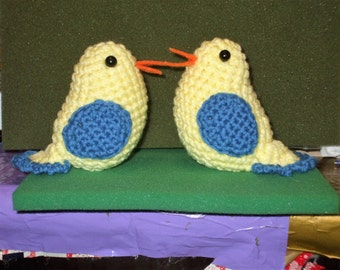 a pair of crocheted birds