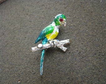Perky parrot pin brooch gold tone with green yellow enamel and red rhinestone eye