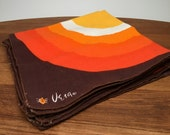 4 Vera Linen Napkins - orange and yellow concentric circles