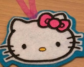 Pink kitty tree ornaments embroidered onto sparkly felt and matching ribbon