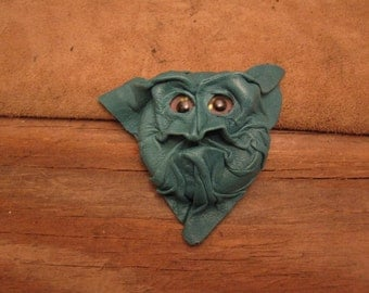 Grichel leather magnet - turquoise with custom mauve and gold glitter eyes