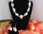 Truly unique and edgy, this chunky, deformed, keshi pearl necklace makes a statement