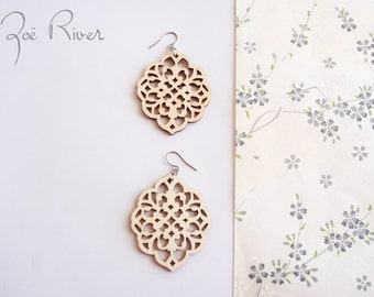 Wood leaf earrings made from laser cut lightweight wood. Wooden leaf earrings.
