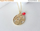 Brass filigree disk pendant swirl style and red necklace
