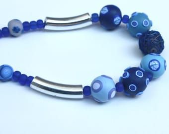 Festive long necklace in blue, polymer clay beads