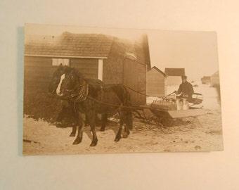 vintage horse drawn sleigh with milk cans bottles, dairy milkman