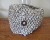 Chunky hand knit cowl in natural oatmeal with brown and black flecks, one wooden button and FREE SHIPPING to the 50 United States