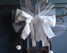 Shabby grapevine angel- with netting, muslin, crochet lace, and rose accents.