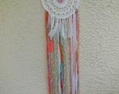 Crochet handmade bohemian dream catcher with feathers picks.