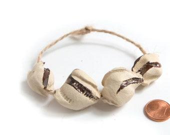 Bistolida Hirundo  -- a set of 4 textured ceramic beads