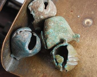 Set of 4 antique brass jingle bells. Broken. Black patina of time.