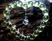 LT Stained glass green Heart shaped nugget sun catcher light catcher with crystal heart in center made with glass nuggets
