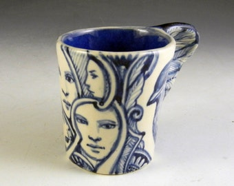 Blue and white porcelain bird wing handle cup with faces and rabbit, OOAK