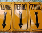 1 Vintage French Yellow Metal 'TERRE (EARTH)' Arrow Sign
