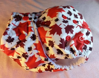 SassyCloth one size pocket diaper with Canada maple leaves PUL print. Made to order.