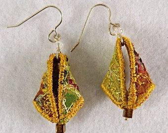 Textile earrings in antique gold with hints of green and rust