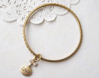 "Thin Gold ""love"" Bangle"