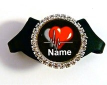 Stethoscope Bling ID name tag, fits all 3M Littmann stethoscopes.Your name professionally imprinted. Glass dome enhances the image