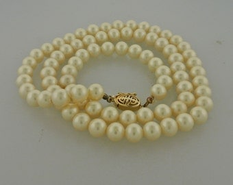 Faux Pearl Necklace with Gold Tone Asian Style Safety Clasp.