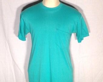 1980's aqua blank pocket t-shirt, fits like a medium