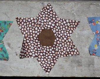 1930's 1940's handpieced star quilt blocks, colorful, calico floral, feedsack or feed sack and other fabric, 2 with water stain, 8 fine!