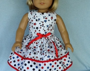 18 inch doll dress and hair clip.  Fits American Girl Dolls.  Patriotic double ruffled dress.