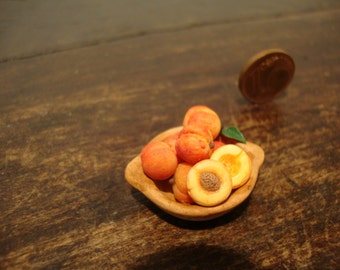 Miniature earthenware bowl with  peaches