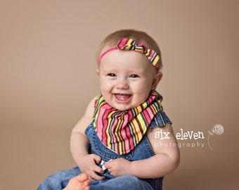 "Cowl style bandana bib ""candy stripe"" fabric.  Matching knotted bow headband also available."